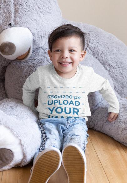 Heathered Long Sleeve Tee Mockup of a Kid Sitting by a Teddy Bear 28098
