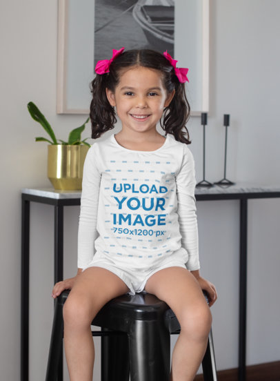 Long Sleeve Tee Mockup of a Smiling Girl Sitting on a Modern Stool 28086