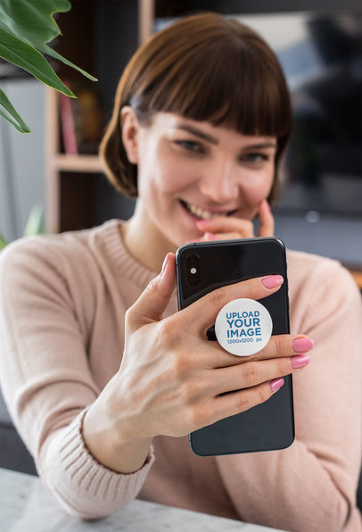 PopSocket Mockup of a Woman Holding Her iPhone 28157