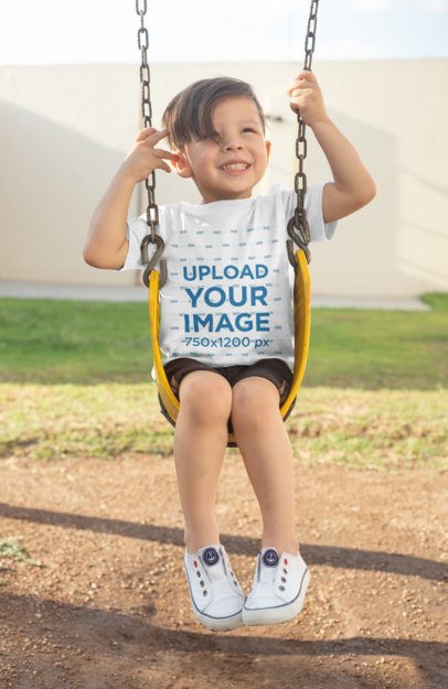 T-Shirt Mockup of a Boy Playing on a Swing 28082