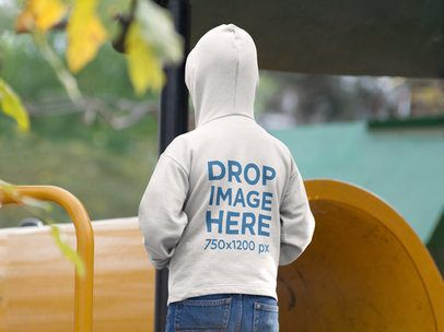 Mockup of the Back of a Boy Wearing a Hoodie at the Park a9103b