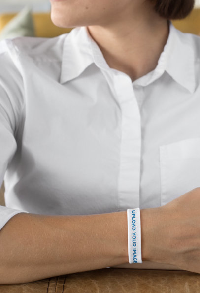 Mockup of a Woman Wearing a Silicone Wristband 28214