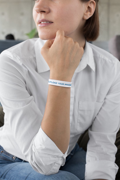 Mockup of a Woman with a White Shirt Wearing a Silicone Wristband 28215