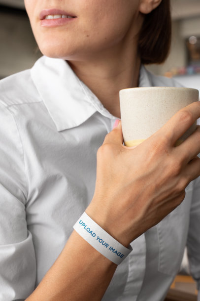 Paper Wristband Mockup Featuring a Woman Holding a Coffee Cup 28218