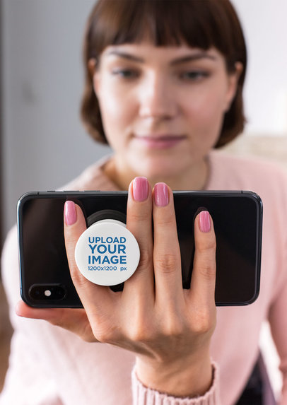 PopSocket Mockup of a Woman Holding Her Cellphone in Landscape Mode 28156