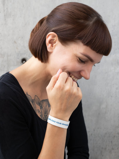 Mockup of a Tattooed Woman Wearing a Paper Wristband 28220