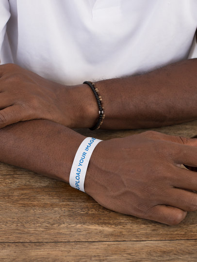 Paper Wristband Mockup of a Man at a Table 28239
