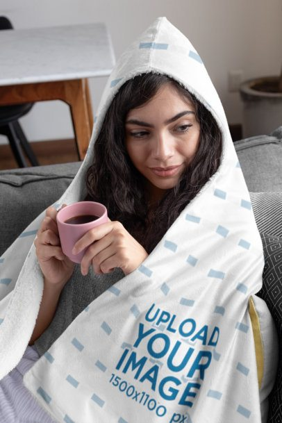 Mockup of a Young Woman Covered with a Hooded Blanket 28135