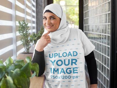 T-Shirt Mockup of a Woman Wearing a Hijab in a Hallway 28282
