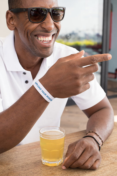 Paper Wristband Mockup Featuring a Man with Sunglasses 28236