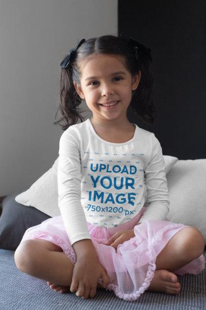 Long Sleeve T-Shirt Mockup of a Girl Sitting Cross-Legged and Smiling 28108