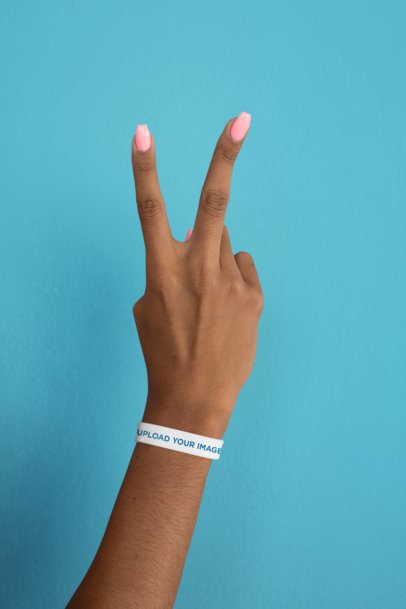 Silicone Wristband Mockup of a Woman's Hand Making the Peace Sign 28234