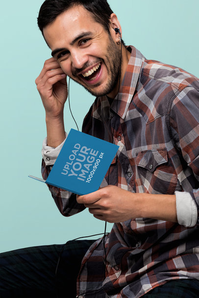 Digipak Mockup Featuring a Smiling Man Listening to Music 28326