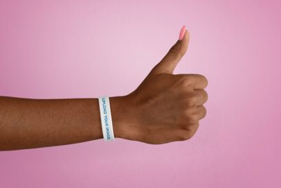 Silicone Wristband Mockup of a Woman's Hand Giving Thumbs Up 28238