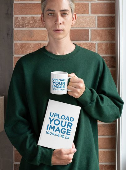 Mockup of a Young Man Posing with a Coffee Mug and a Book 28456