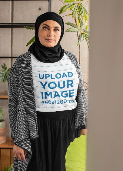 T-Shirt Mockup of a Senior Woman Wearing a Hijab 28286