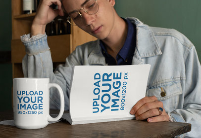 Mockup of a Young Man Reading a Book with a 15 oz Coffee Mug by His Side 28462