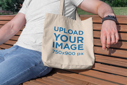 Tote Bag Mockup Featuring a Man Sitting on a Wooden Bench 195-el