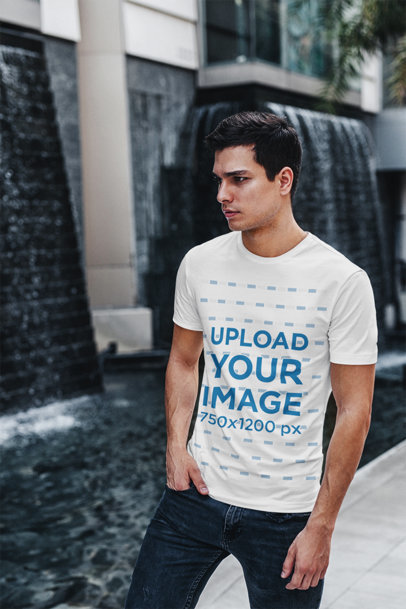T-Shirt Mockup of a Young Man Walking on a Street 423-el