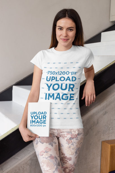Mockup of a Woman Wearing a T-Shirt Leaning on a Staircase with a Book in Her Hand 28489