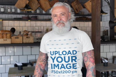 T-Shirt Mockup of a Bearded Senior with Tattooed Arms 28428