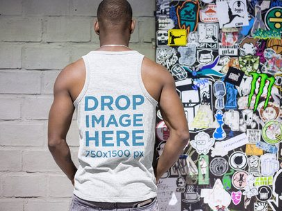 Back of a Black Man Wearing a Tank Top While in a Subway Station a9380b