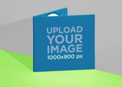 Mockup of a Digipak Standing Over Two Colored Papers 28346