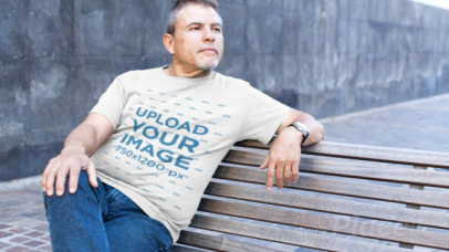 T-Shirt Video of a Mature Man Sitting on a Street Bench 12749