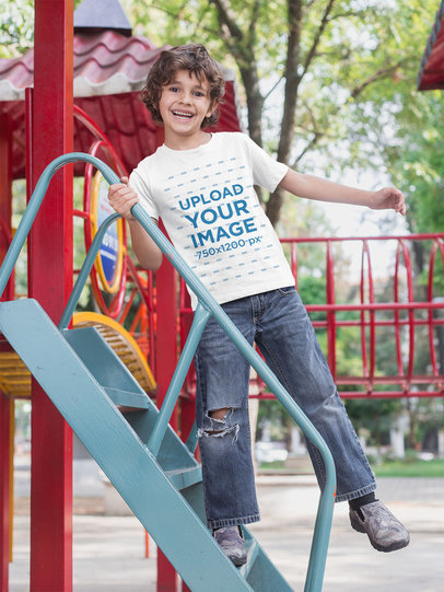 T-Shirt Mockup of a Boy Playing Happily in the Park 28113