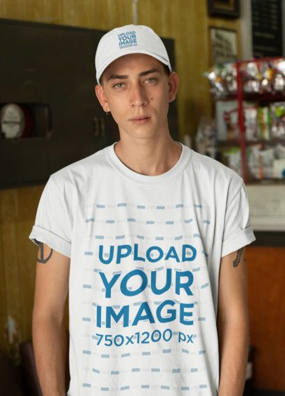 Mockup of a Young Tattooed Man Wearing a Dad Hat and a T-Shirt 28583