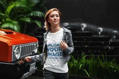 T-Shirt Mockup of a Young Woman Walking by an All-Terrain Truck 412-el