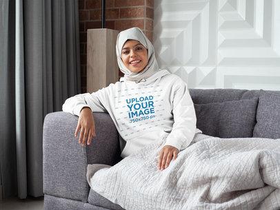Mockup of a Woman with a Hijab Lying on a Sofa 28392