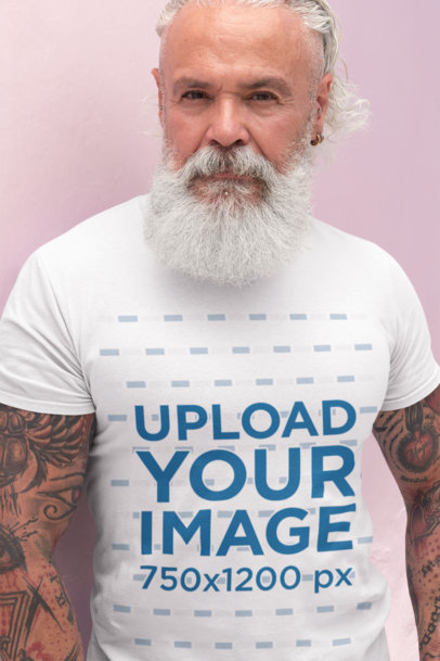 T-Shirt Mockup of a Senior Man with a White Beard and Tattooed Arms 28420