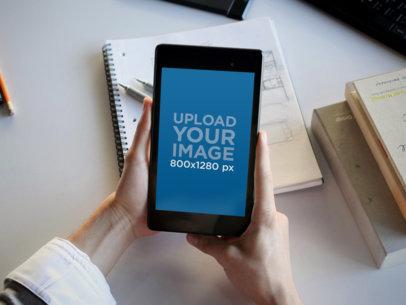 Nexus 7 Mockup Being Held in an Office Environment