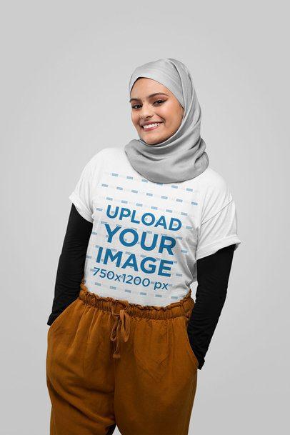 T-Shirt Mockup Featuring a Joyful Woman Wearing a Hijab at a Studio 28386