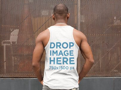 Back of a Man Wearing a Tank Top Mockup While Outside a Restaurant a9351b