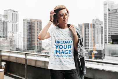 T-Shirt Mockup Featuring a Short-Haired Woman Against a City Landscape 419-el