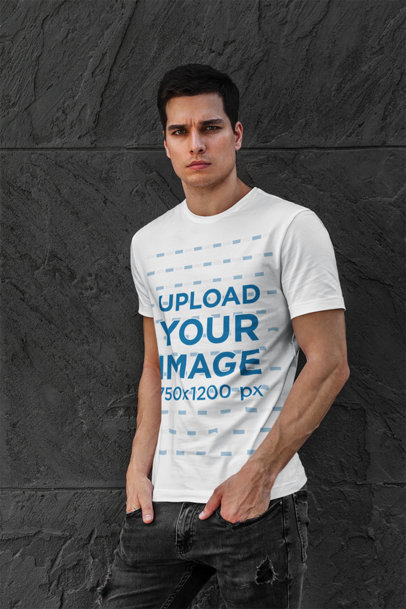 T-Shirt Mockup Featuring a Serious-Looking Man Posing Against a Dark Stone Wall 427-el