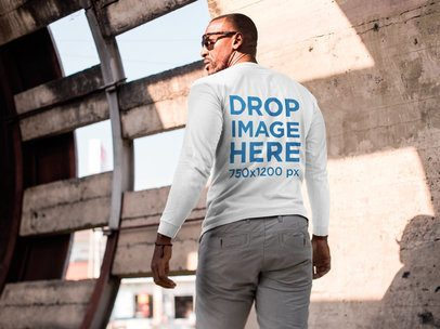 Back of a T-Shirt Mockup of a Black Man at a Construction Site on a Sunny Day a9100b