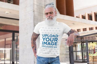 T-Shirt Mockup Featuring a Tattooed Senior Man with Sunglasses 28423
