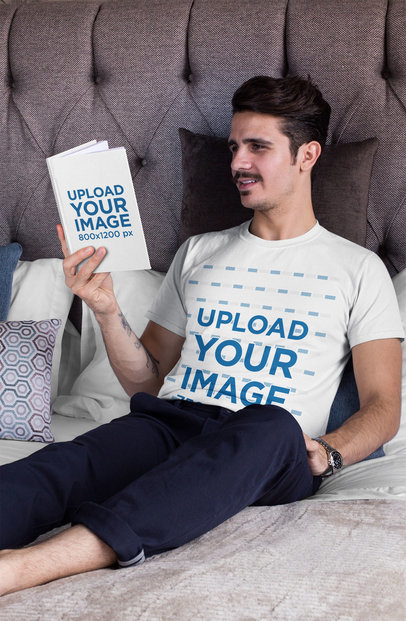 T-Shirt Mockup of a Man Reading a Book in his Bed 28488