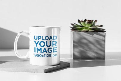 11 oz Coffee Mug Mockup Featuring a Plant Pot Having a Sunbath 394-el