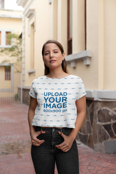 Sublimated Cropped T-Shirt Mockup of a Woman Standing Outside a House 28557