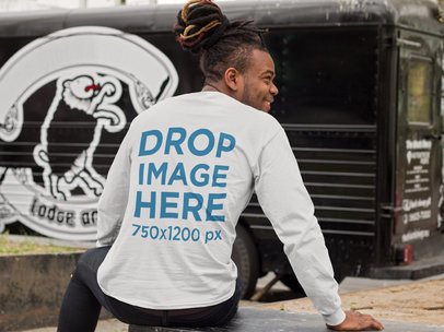 Back of a Man with Dreadlocks Wearing a Long Sleeve Tee Mockup Sitting Outdoors a9290b