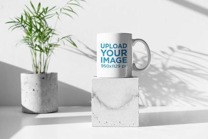 11 oz Coffee Mug Mockup Placed over a Minimalist Concrete Cube 395-el