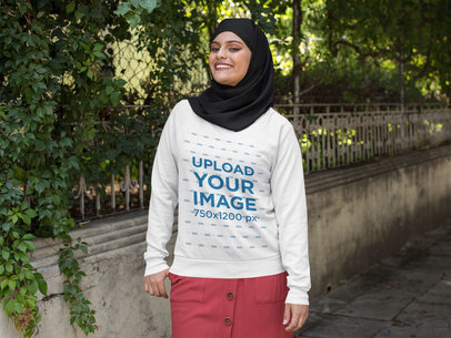Crewneck Sweatshirt Mockup of a Woman with a Hijab Walking on the Street 28409