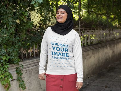 Crewneck Sweatshirt Mockup of a Woman with a Hijab Walking on the Street 28409