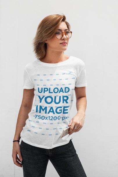 T-Shirt Mockup Featuring a Short-Haired Woman Posing in Front of a White Wall 413-el