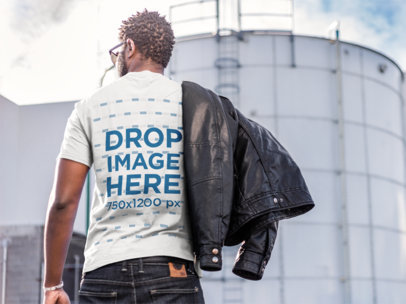 Back Mockup of a Stylish Black Man Wearing a T-Shirt at an Industrial Area a9526b
