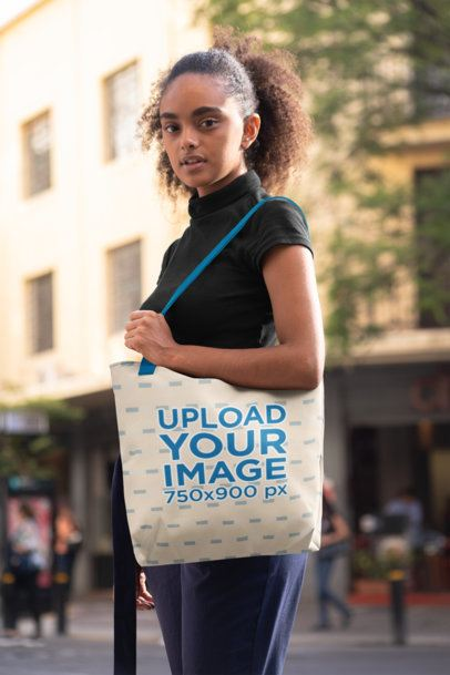 Mockup of a Woman with Kinky Hair Carrying a Tote Bag on Her Shoulder 28844